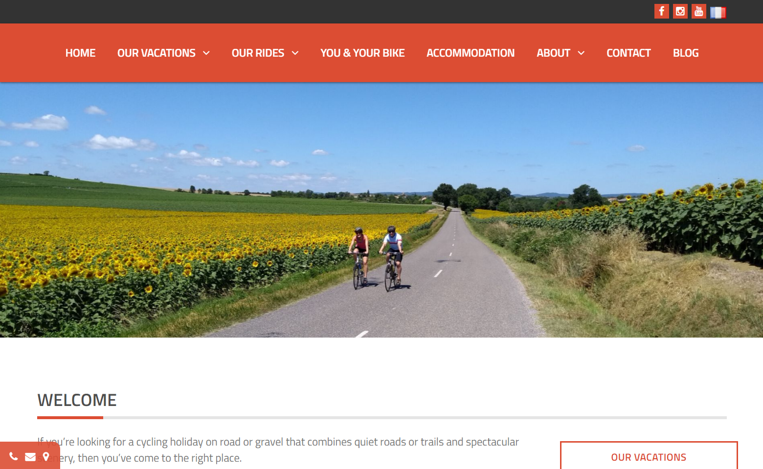 A clean website front page with a red header menu followed by an image of two cyclists riding through sunflowers with text describing the business underneath